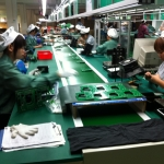 Employees at the production line